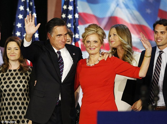 Republican presidential nominee Mitt Romney stands on stage with his wife Ann after he delivered his concession speech during his election night rally in Boston, Massachusetts, November 7