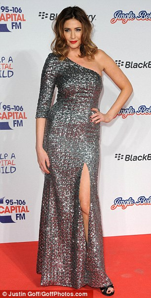 Stunning: Lisa showed off her great figure in the sequined dress