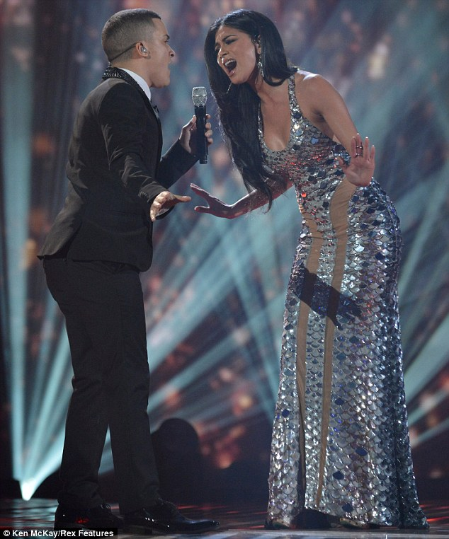 Real stars: The two singers continued to belt out the song in perfect harmonies