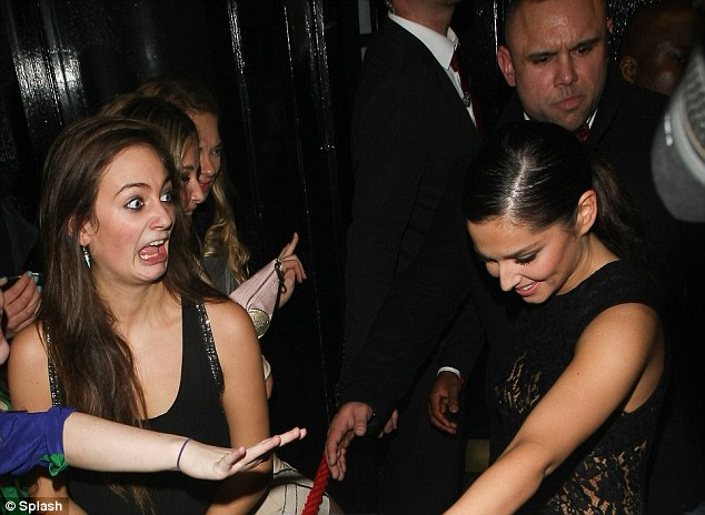 Look who it is: One female fan of Cheryl's went crazy when she saw the pop star leave the club