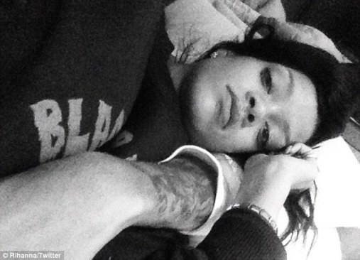 Sweet thing: Rihanna later tweeted a picture of herself lying in Brown's arms