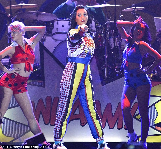 Pow! Earlier at the start of her performance, the raven-haired star had on a parachute-style jumpsuit in a similar print as she moved alongside her back-up dancers