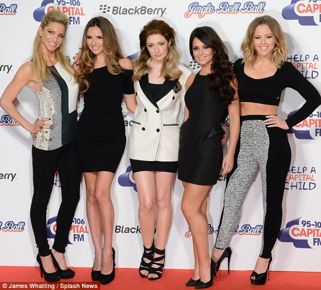 Looking great girls: The band beamed as they showed off their looks, but Cheryl won in the style stakes thanks to her LBD