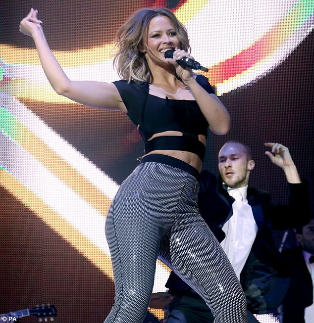 Not waist-ing an opportunity: Kimberley was seen showing off her abdominals as she performed