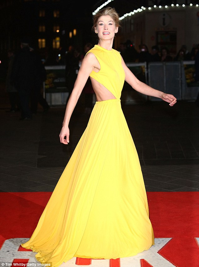 Bringing the sunshine: Rosamund Pike wears a show-stopping Alexander McQueen gown to the Jack Reacher premiere