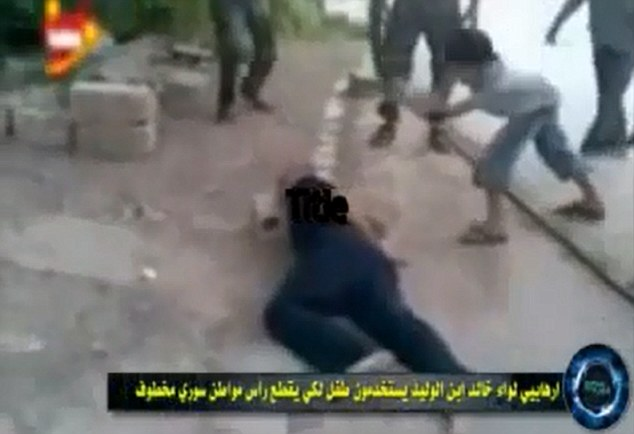 Video nasty: A young boy, apparently being egged on by Syrian rebel fighters, uses a sword to cut the head off man in this disturbing clip that has been uploaded onto the internet