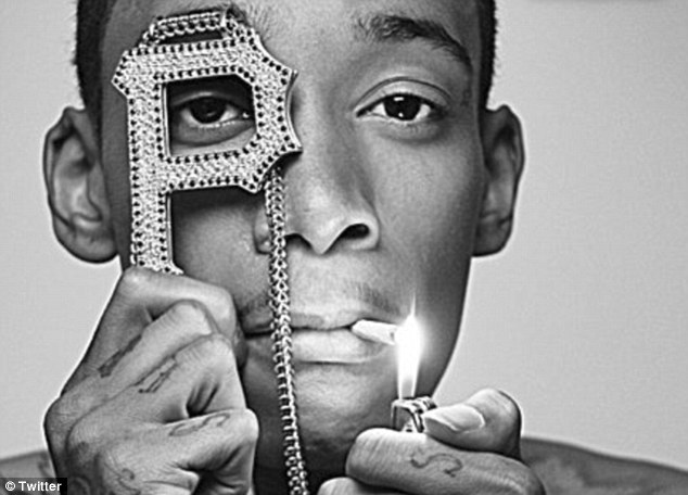 'Showing him right': Wiz, who often raps about smoking marijuana, says he is looking forward to be the best father he can be