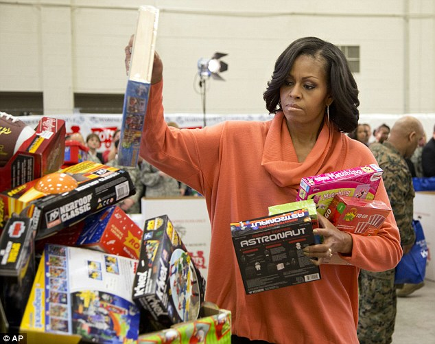 Friendly reminder: Helping sort the gifts by age, she noted the often lack of gifts for older children with most donors providing toys for the youngest out there