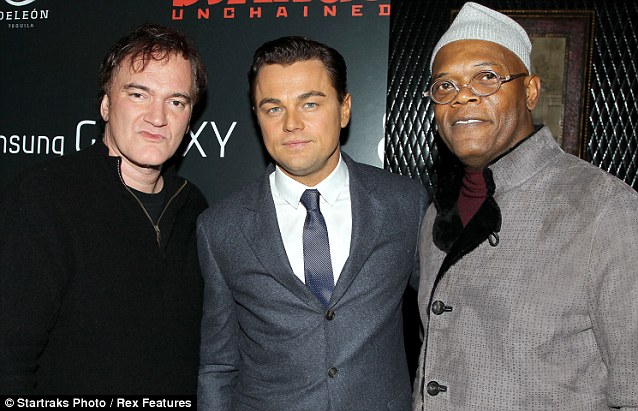 Reunion: Quentin was also reunited with his Pulp Fiction star Samuel L Jackson who arrived at the premiere in a warm woolly hat