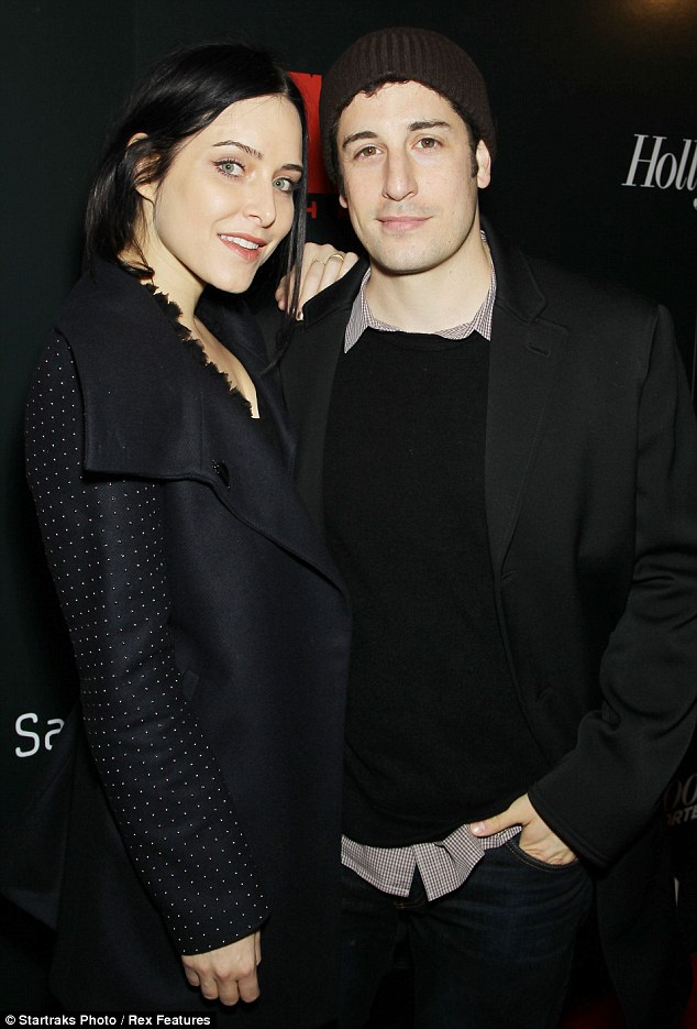 Cute couple: Jason Biggs and his wife Jenny Mollen cuddled up on the red-carpet
