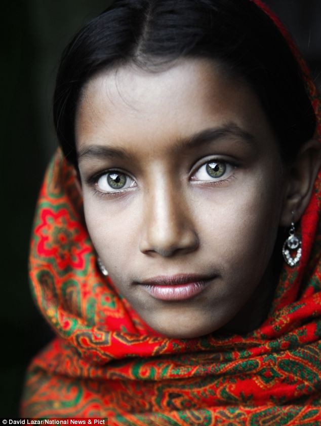 Stunning: A girl with green eyes wearing a headscarf in Putia, a Bangladeshi village