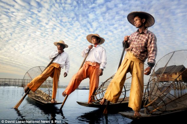 Burmese Fishermen on Inle Lake: The fisherman of this region have a unique rowing technique, where they stand on the stern on one leg and wrap the other leg around the oar allowing for fine paddle control