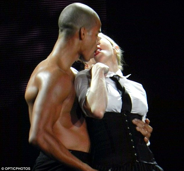 Saucy: Madonna certainly didn't gold back with her very public display of passion, with the star ramming her tongue straight down the throat of her man