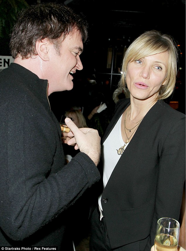 Getting a sweat on: Quentin seems to be feeling the heat as he starts sweating while chatting to Cameron Diaz