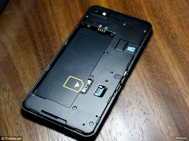 A peek inside the phone shows slots for a micro-SIM and microSD memory card