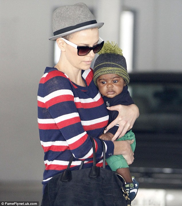 Pride and joy: Not seen Saturday was Charlize's nine-month-old son Jackson, whom she adopted last May