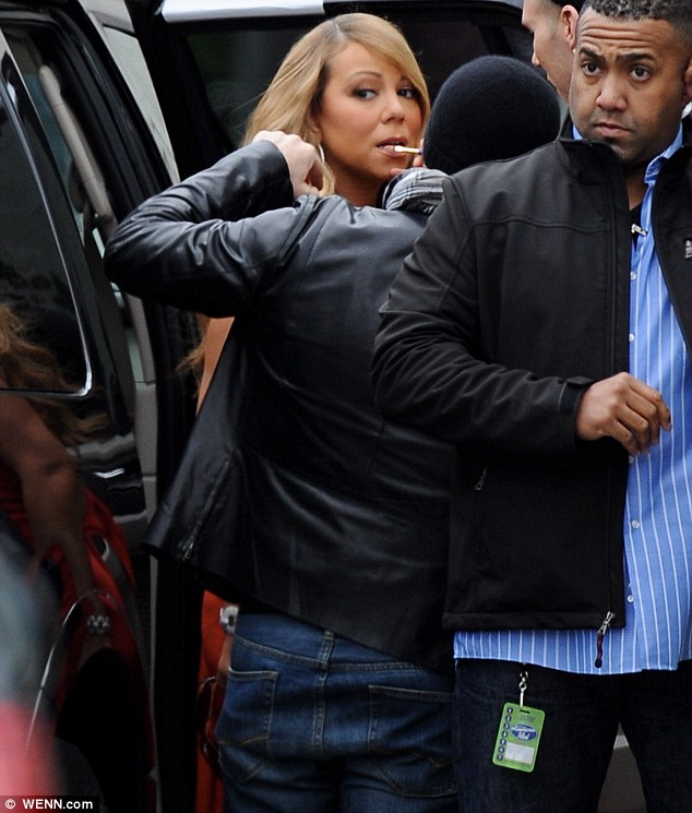 Entourage: Mariah was surrounded by several stylists, make-up artists and assistants