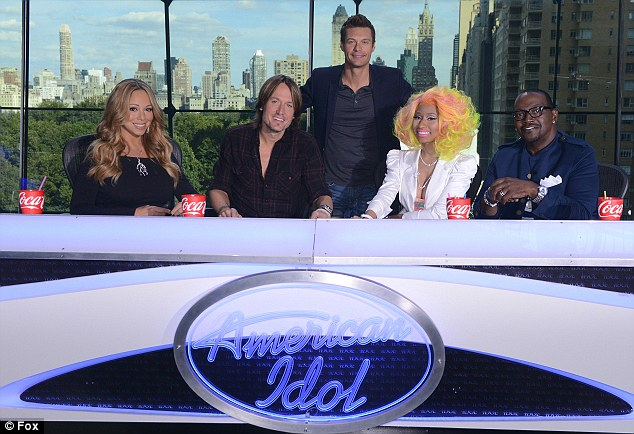 The line-up: All the judges pose with host Ryan Seacrest in an official American Idol photograph