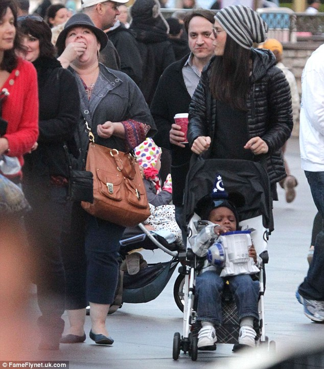 Day with Disney: Sandra pushed Louis in his buggy as Melissa enjoyed a snack
