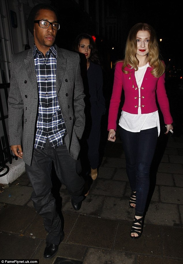 Date night for three: Tre went for smart casual in trousers, a checked shirt, tailored jacket and beanie hat