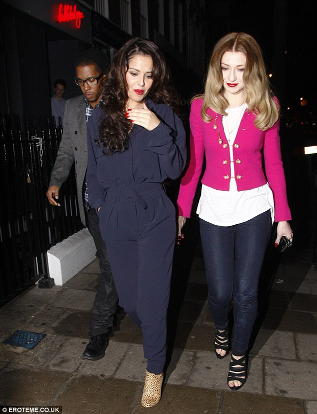 Centre of attention: Cheryl walked along with her boyfriend and best pal by each of her sides
