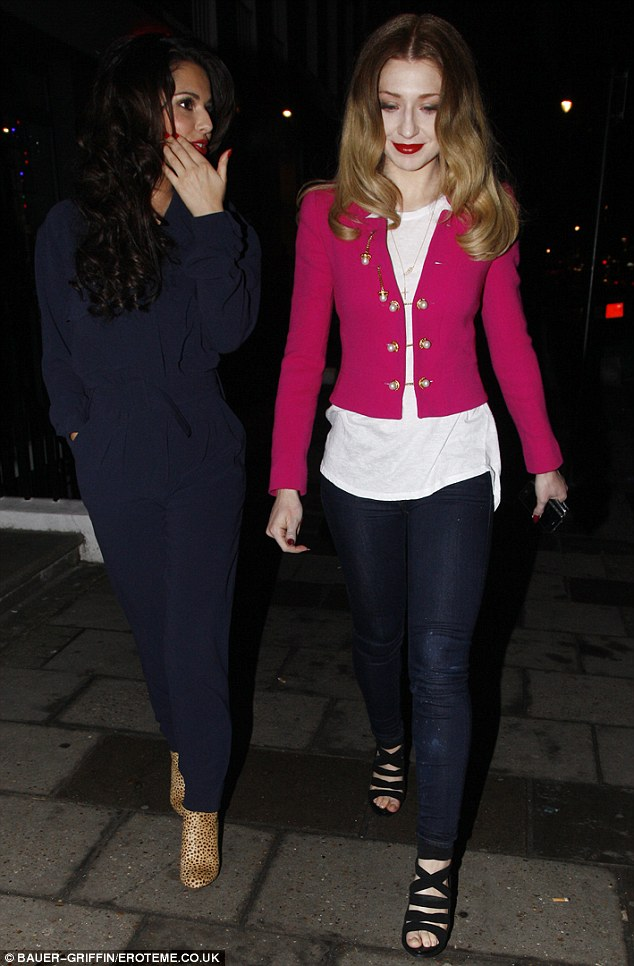Girly gossip: Cheryl and Nicola chatted away as Tre followed closely behind