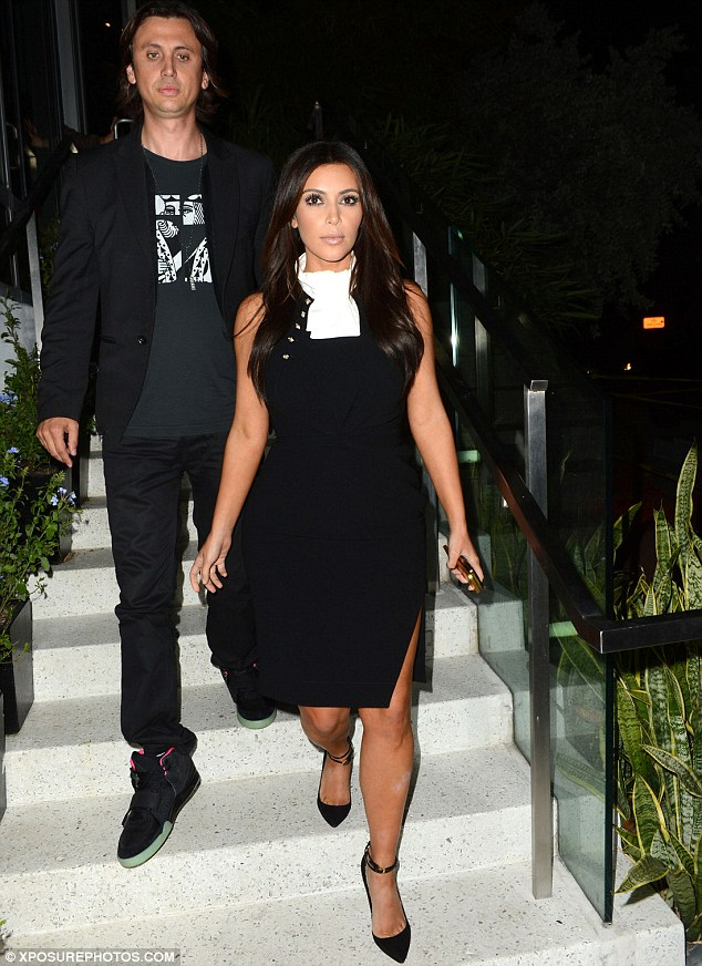 Not a good look: Kim, here seen with BFF Jonathan, didn't pull off the odd-looking bib-like accessory