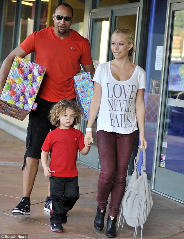 No peeking: Kendra pulls along Hank Jr. as his dad walks carefully bearing gifts