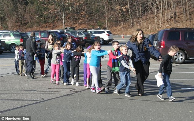 Tragic: Traumatized students were seen being led out of the school crying and holding hands after the massacre