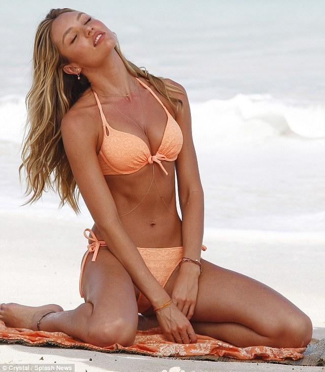Ripe as a peach: The Victoria's Secret angel lets her hair down as she models peach lace bikini