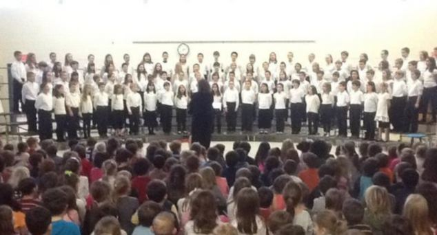 This picture was recently taken of an assembly at Sandy Hook elementary, with hero music teacher Maryrose Kristopik conducting the choir