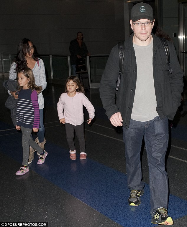Out in front: Matt led the way as the family made their way through the arrival lounge at the airport