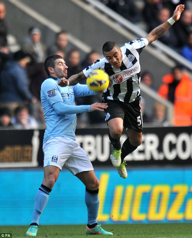 Giving it his all: Simpson and Man City's Alexandar Kolarov (L) go head to head for the ball