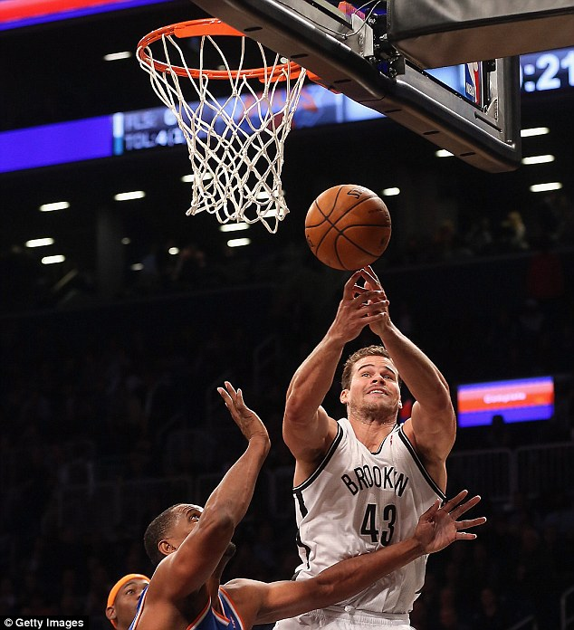 Stick with what you know: When he's not trying to make people laugh, Humphries plays for Brooklyn Nets