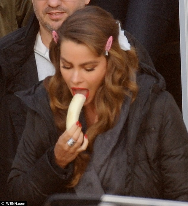Quick snack: The actress snacked on a banana while she waited on her hair to set