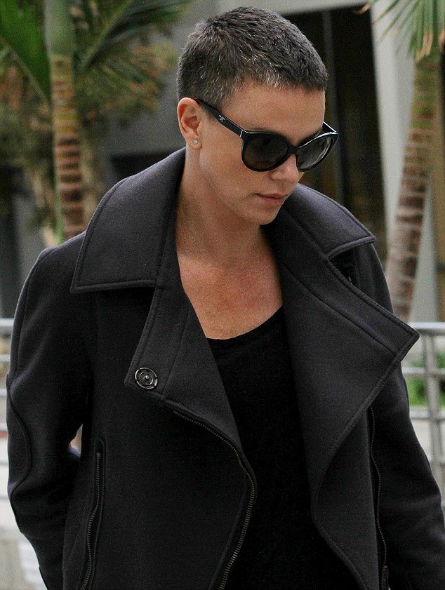 Brave beauty: Charlize Theron steps out with her natural grey hair in Beverly Hills, California, on Saturday