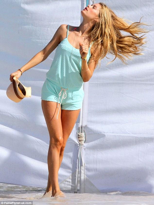 Caribbean splendour: The Dutch model took a moment to enjoy the hot Caribbean sun