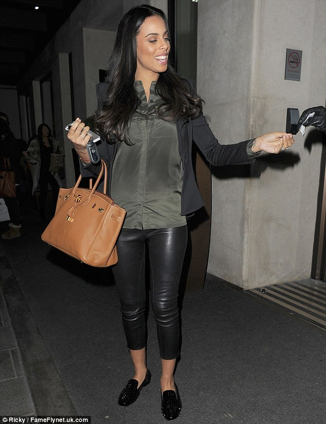 Mother-to-be: The Saturdays' singer wore her glossy hair down in loose girls as she kept her make-up light