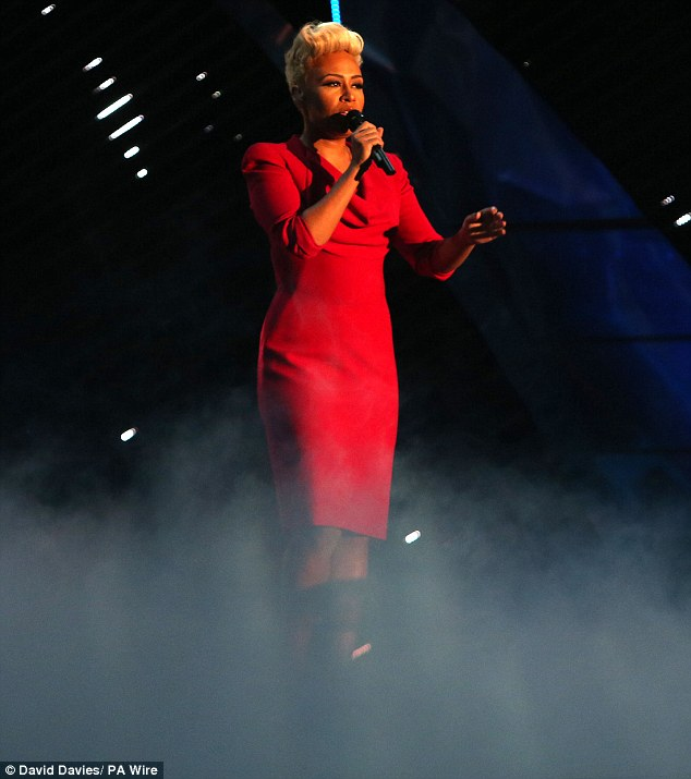 Entertaining the crowds: Emeli Sande also went for red as she belted out some tracks for the audience