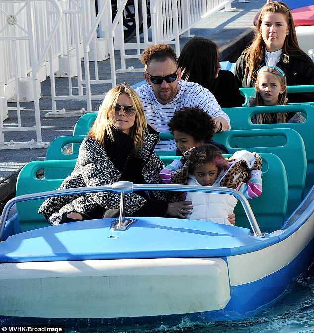 Row your boat: The 39-year-old took her children Leni, 8, Henry, 7, Johan, 5 and Lou, 3 aboard the It's A Small World Ride