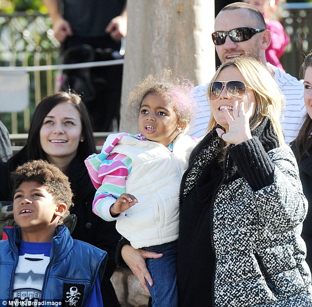 Family day out: Heidi Klum and her new boyfriend Martin Kristen gave her family a Christmas treat taking them to Disneyland on Saturday