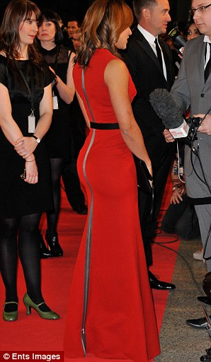 Body confident: Jessica Ennis looked stunning in a Victoria Beckham red dress which showcased her figure at the Sports Personality of the Year awards