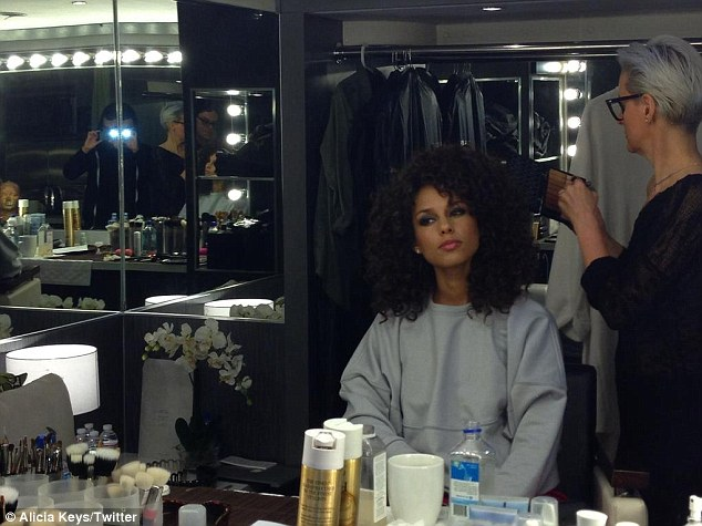 New style: Alicia reverted to her naturally curly locks earlier this week