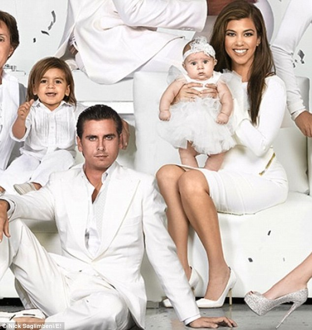 Happy family: Penelope makes her first appearance on the car in a shot with her mother Kourtney, father Scott Disick and brother Mason