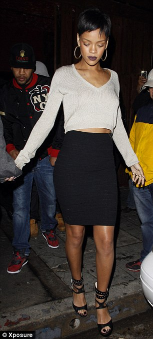 Party like a rock star: Rihanna, pictured on Sunday, had been partying in Los Angeles and now has a new base