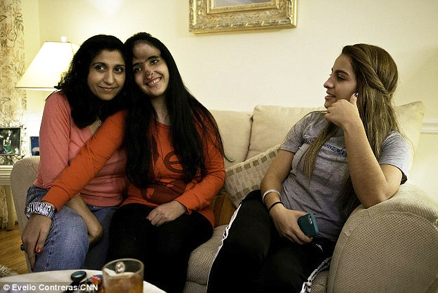 At ease: Aesha, who believes she is 21 or 22, is pictured with her mother figure Jamila Rasouli-Arsala