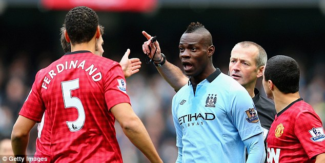 Heated: Rio Ferdinand of Manchester United and Mario Balotelli have words during the hotly-contested Manchester derby nine days ago