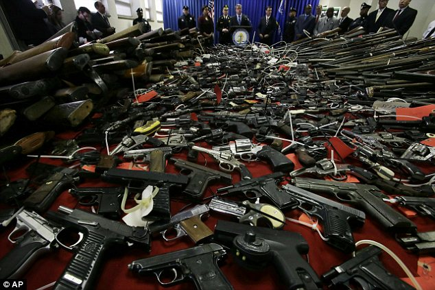 Cash for guns: Those who came to the event were paid up to $250 per weapon with 'no questions asked'