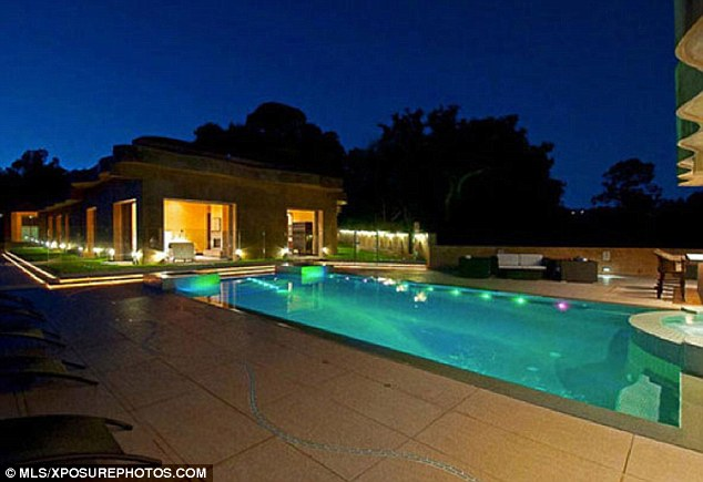 Evening dip: With all of this space, Rihanna could certainly enjoy a quiet swim to tune out the world - or take some more Twitter photos