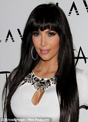 Switching things up: Last year Kim tried out a fringe for New Years and in 2009 she went blonde